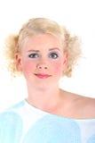 Mujer rubia que parece sorprendida Imagen de archivo libre de regalías