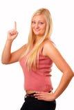 Mujer rubia que se divierte en camisa roja Imagen de archivo