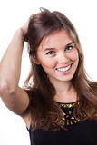 Mujer rubia que toca su pelo Imágenes de archivo libres de regalías