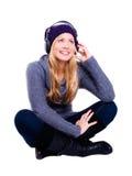 Mujer rubia sonriente con los auriculares Fotografía de archivo libre de regalías