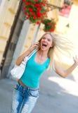 Mujer salida con el teléfono móvil Fotografía de archivo libre de regalías