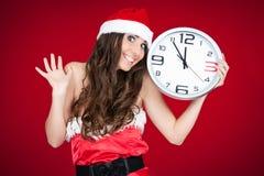 Mujer salida de santa con el reloj - Año Nuevo Imagen de archivo