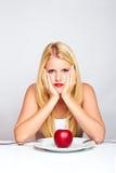 Mujer sana triste con la manzana Imagenes de archivo