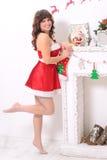 Mujer sensual joven en vestido de los Años Nuevos Fotografía de archivo libre de regalías