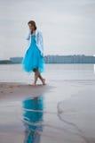 Mujer sola en la playa Imágenes de archivo libres de regalías