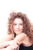 Mujer sonriente aislada en blanco Imágenes de archivo libres de regalías
