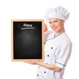 Mujer sonriente bonita del cocinero que sostiene la pizarra del menú Fotos de archivo