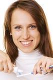 Mujer sonriente con crema dental y el cepillo de dientes Fotografía de archivo