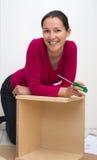 Mujer sonriente con destornillador Fotos de archivo libres de regalías
