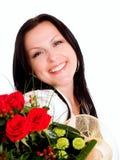Mujer sonriente con el ramo de flores Imágenes de archivo libres de regalías