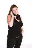 Mujer sonriente con el teléfono Fotos de archivo libres de regalías