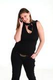 Mujer sonriente con el teléfono Imagenes de archivo