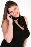 Mujer sonriente con el teléfono Imagen de archivo