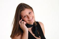 Mujer sonriente con el teléfono Imagen de archivo libre de regalías