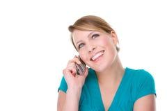 Mujer sonriente con la célula Imágenes de archivo libres de regalías