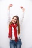 Mujer sonriente con las manos aumentadas para arriba Imagen de archivo libre de regalías