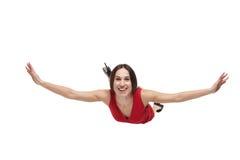 Mujer sonriente con las manos extendidas que flotan en el aire Foto de archivo