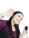 Mujer sonriente con los auriculares y el mp3 Fotografía de archivo libre de regalías
