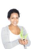 Mujer sonriente con los bulbos sping del brote Imagen de archivo