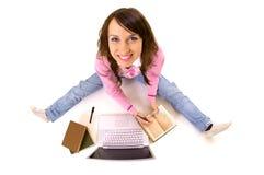 Mujer sonriente con los libros y la computadora portátil Imagenes de archivo