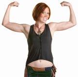 Mujer sonriente con los músculos fotos de archivo libres de regalías