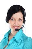 Mujer sonriente del operador en un centro de atención telefónica Fotos de archivo libres de regalías