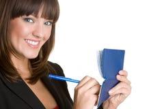 Mujer sonriente del talonario de cheques Imágenes de archivo libres de regalías