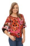 Mujer sonriente en blusa de moda Fotos de archivo