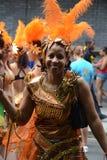Mujer sonriente en el carnaval, Notting Hill Imágenes de archivo libres de regalías