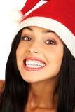 Mujer sonriente en el casquillo de Santa Imágenes de archivo libres de regalías