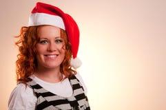 Mujer sonriente en el sombrero de santa Imagen de archivo