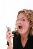 Mujer sonriente en el teléfono celular Imágenes de archivo libres de regalías
