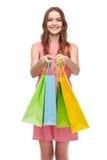 Mujer sonriente en vestido con muchos panieres Foto de archivo libre de regalías