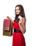 Mujer sonriente en vestido rojo con los panieres Fotografía de archivo libre de regalías