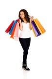 Mujer sonriente feliz con los bolsos de compras Imagen de archivo