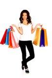 Mujer sonriente feliz con los bolsos de compras Imágenes de archivo libres de regalías