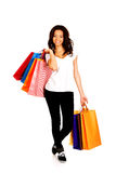 Mujer sonriente feliz con los bolsos de compras Fotos de archivo libres de regalías
