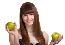 Mujer sonriente feliz joven con la manzana verde Fotos de archivo libres de regalías