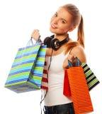 mujer sonriente feliz joven con los bolsos de compras Imagen de archivo libre de regalías
