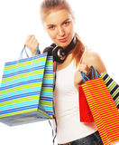 mujer sonriente feliz joven con los bolsos de compras Fotografía de archivo