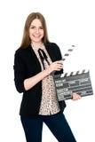 Mujer sonriente hermosa que sostiene una chapaleta de la película Foto de archivo