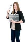 Mujer sonriente hermosa que sostiene una chapaleta de la película Fotos de archivo libres de regalías