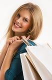 Mujer sonriente joven con los panieres aislados Fotos de archivo libres de regalías