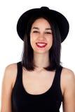 Mujer sonriente joven con ropa negra Imagen de archivo libre de regalías