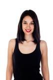 Mujer sonriente joven con ropa negra ajustada Imagen de archivo