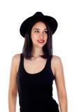 Mujer sonriente joven con ropa negra ajustada Imágenes de archivo libres de regalías