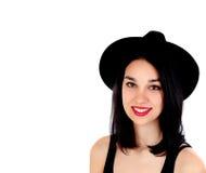 Mujer sonriente joven con ropa negra ajustada Fotos de archivo libres de regalías