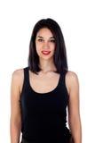 Mujer sonriente joven con ropa negra ajustada Foto de archivo libre de regalías