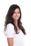 Mujer sonriente joven hermosa con el pelo negro largo aislado en a Fotografía de archivo