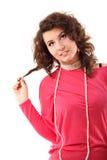 Mujer sonriente pensativa joven Imagen de archivo libre de regalías
